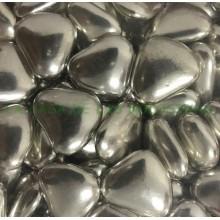 Peladillas corazón color plata rellenas de chocolate bolsa 1Kg.