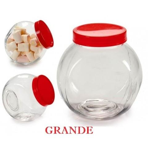Tarro grande de cristal con tapa roja inclinado